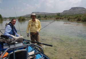 Two anglers fishing the Devil's River in Texas via raft