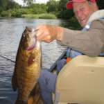Client holding a big smallmouth bass