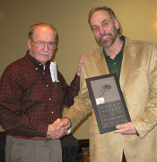 Tim receiving an award from Dr Thomas F. Waters