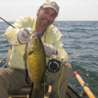 Tim in a canoe with a big smallie