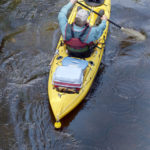 overhead view of a kayak with anchor system