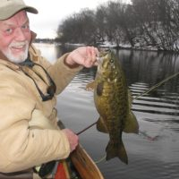 Dan Johnson in winter with a big smallmouth