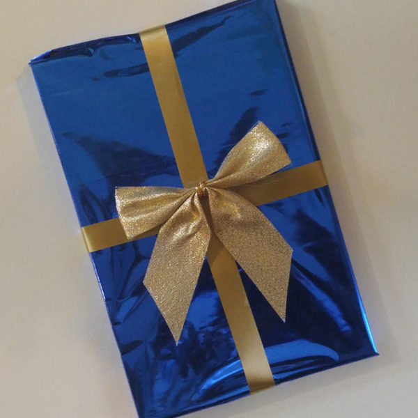 This book, gift-wrapped in blue foil with gold ribbon